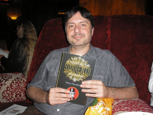 Henry Chamberlain with a copy of A Night at the Sorrento and Other Stories at the Sorrento Hotel