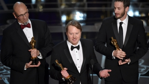 Producer Roy Conli, from left, Directors Don Hall, and Chris Williams accept the award for best animated feature film for Big Hero 6 at the Oscars on Sunday at the Dolby Theatre in Los Angeles. (John Shearer/Invision/The Associated Press)