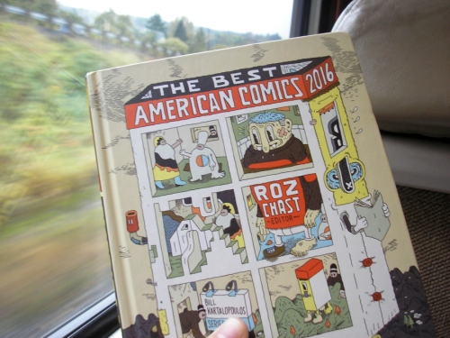 "Reading ""Best American Comics 2016"" on the train."